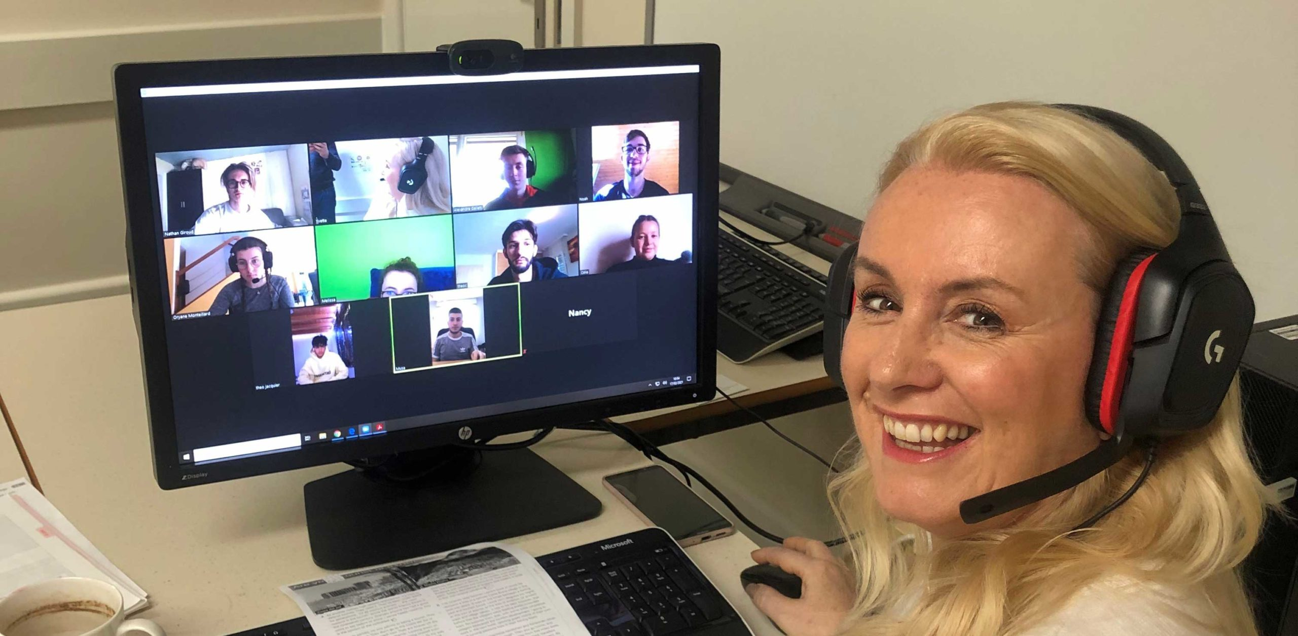 Yvette teaching students via video call